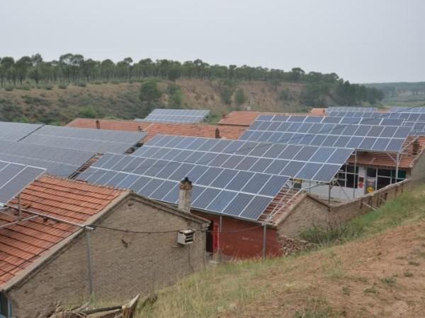 《人民日报》发表章建华署名文章: 积极开发光伏电站等可再生能源
